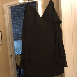 A black dress with shear off shoulder sleeves